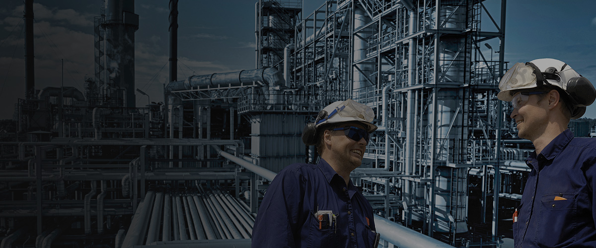 Workers in refinery